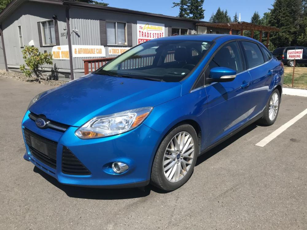2012 Blue /Black Ford Focus SEL Sedan (1FAHP3H28CL) with an 2.0L L4 DOHC 16V engine, 6-Speed Automatic transmission, located at 1283 SE Sedgwick Road, Port Orchard, WA, 98366, (360) 876-9300, 47.505535, -122.635643 - Photo #0