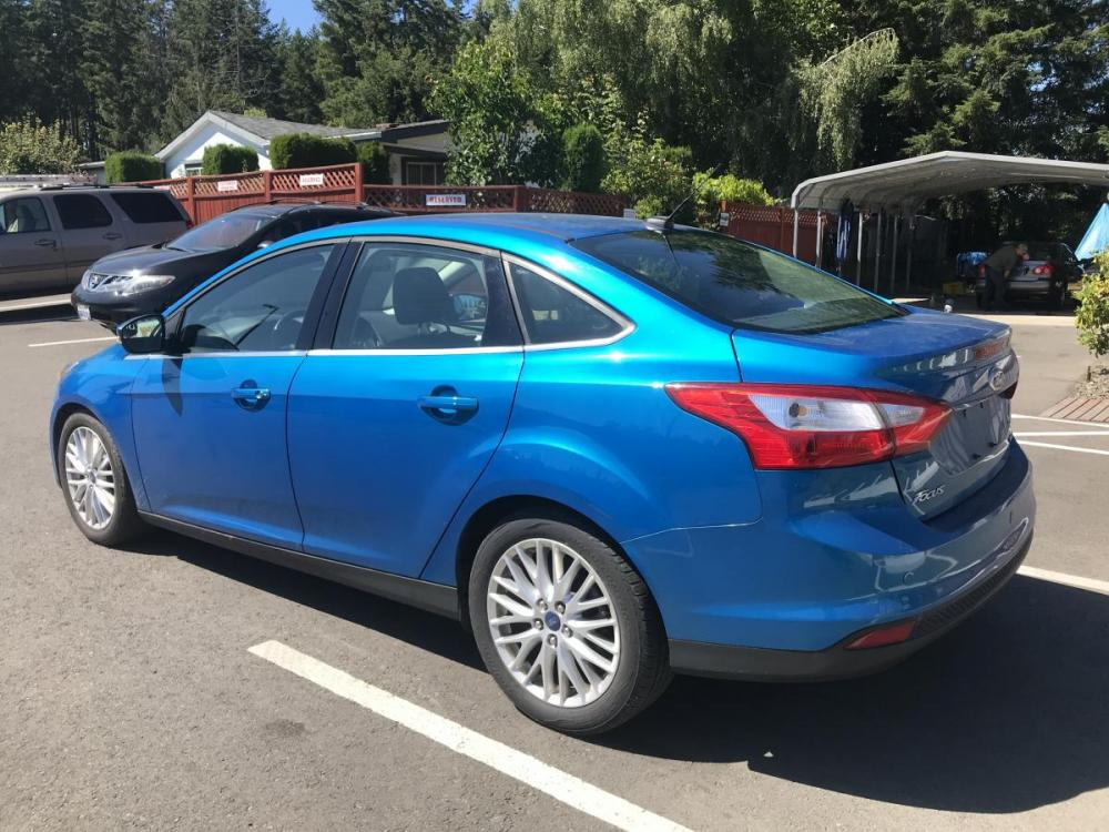 2012 Blue /Black Ford Focus SEL Sedan (1FAHP3H28CL) with an 2.0L L4 DOHC 16V engine, 6-Speed Automatic transmission, located at 1283 SE Sedgwick Road, Port Orchard, WA, 98366, (360) 876-9300, 47.505535, -122.635643 - Photo #1