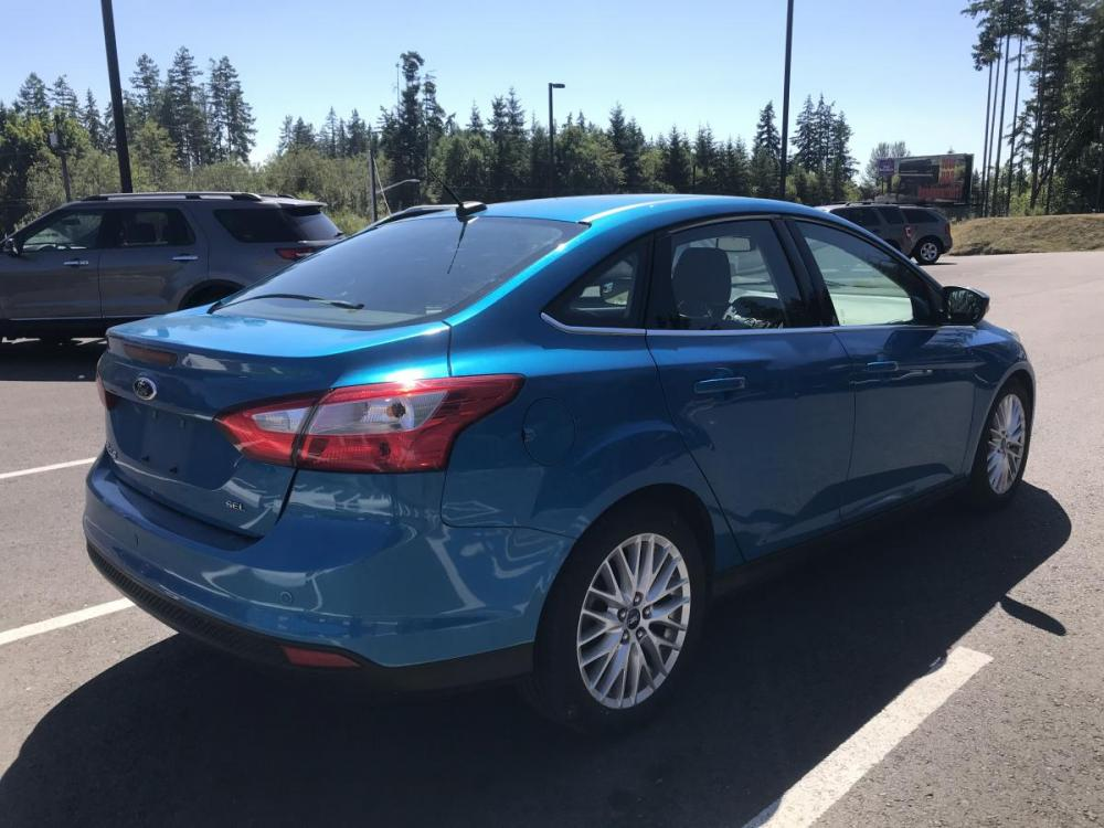 2012 Blue /Black Ford Focus SEL Sedan (1FAHP3H28CL) with an 2.0L L4 DOHC 16V engine, 6-Speed Automatic transmission, located at 1283 SE Sedgwick Road, Port Orchard, WA, 98366, (360) 876-9300, 47.505535, -122.635643 - Photo #2