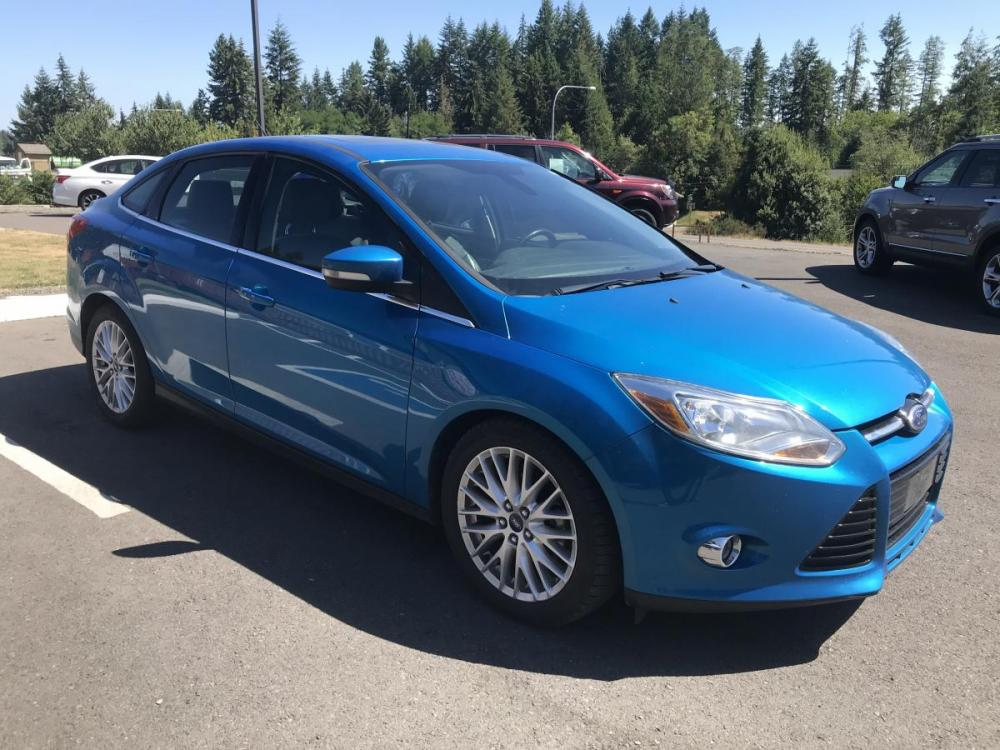2012 Blue /Black Ford Focus SEL Sedan (1FAHP3H28CL) with an 2.0L L4 DOHC 16V engine, 6-Speed Automatic transmission, located at 1283 SE Sedgwick Road, Port Orchard, WA, 98366, (360) 876-9300, 47.505535, -122.635643 - Photo #3